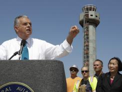 Transportation Secretary Ray LaHood speaks in front of the under-construction air traffic control tower near the Oakland Airport on Tuesday.