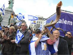 Pro-Israel demonstrators blow the 'shofar', a ram's horn, during a demonstration against the possible division of Jerusalem, in Brussels, Sept. 19.