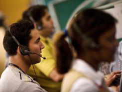Employees at a call center near New Delhi.