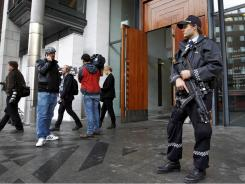 Reporters and police stand at the entrance of the courthouse where right-wing extremist  and mass killer Anders Behring Breivik is due to make his third court appearance in Oslo.