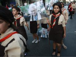 Palestinian scouts march during a rally to support statehood Monday at the United Nations, in the West Bank village of Beit Sahour, near Bethlehem.