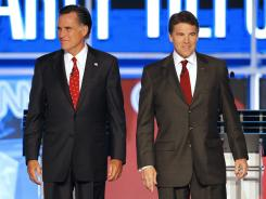 Texas Gov. Rick Perry, right, and former Massachusetts governor Mitt Romney appear at the Republican presidential debate Sept. 12 in Tampa.