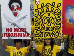 Protesters hold placards during the anti-nuclear march Monday in Tokyo, Japan.