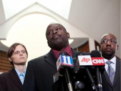 Laura Moye of Amnesty International, Edward DuBose of the NAACP and Raphael Warnock of Ebenezer Baptist Church hold a news conference Tuesday in support of Troy Davis.
