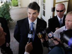 Republican presidential contender Rick Perry speaks with the media after attending a campaign event Wednesday in  Fort Lauderdale.