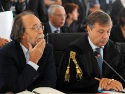 Former official Bernardo de Bernardinis, left, is seen with lawyer Filippo Dinacci at the start of the trial Tuesday.