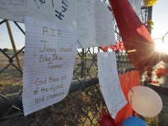 A sign is displayed Monday at a memorial near the Reno-Stead Airport, where the National Championship Air Races were held. Friday's crash at the races left 11 people dead.