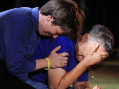 Unitarian minister Lynn Hopkins, left, consoles her spouse, Carolyn Bond, after hearing news that the U.S. Supreme Court had denied a last-minute appeal for Troy Davis.