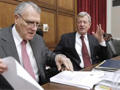 Supercommittee member Sen. Max Baucus, right, speaks with fellow panelist, Sen. Jon Kyl, on Capitol Hill.