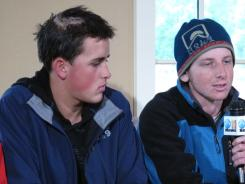 Noah Allaire, left, of Albuquerque, and Sam Melman discuss surviving a bear attack in Palmer, Alaska, on July 25. Allaire received wounds to his head and hand and was bitten on his side during the attack about 120 miles north of Anchorage.