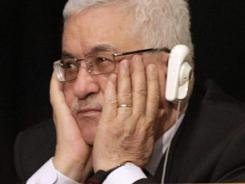 Palestinian President Mahmoud Abbas listens to President Obama address the U.N. on Wednesday.