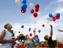 Steve and Kathy Charest launch balloons on July 16 in Springfield, Ill. Hospitals and industrial clients are served helium first, leaving the party industry at the bottom of the pile for helium sales.
