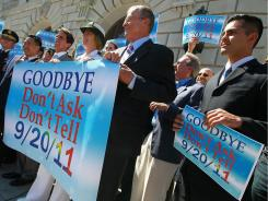 """Local leaders and former members of the military hold a banner during a news conference marking the end of """"don't ask, don't tell"""" on Tuesday in San Francisco, California."""