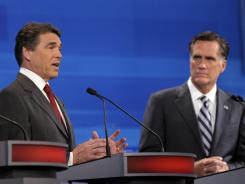 Former Massachusetts governor Mitt Romney listens as Texas Gov. Rick Perry makes a statement during a GOP presidential debate in Florida.