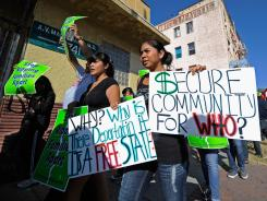 Protesters with Coalition for Humane Immigrant Rights of Los Angeles (CHIRLA) rally against the Secure Communities program on Aug. 15 in Los Angeles.