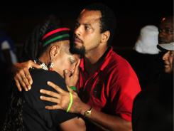 Vizion Jones, center, holds Mercedes Binns, left, after hearing the news of the execution of Georgia death row inmate Troy Davis.