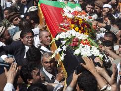 Afghans carry the coffin of  former president Burhanuddin Rabbani during his burial ceremony Friday.