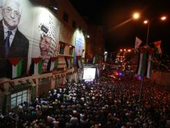 Palestinians watch President Mahmoud Abbas deliver his speech at the General Assembly of the United Nations.