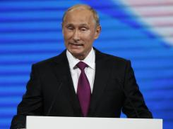 Russian Prime Minister Vladimir Putin addresses the United Russia party's congress Saturday in Moscow.