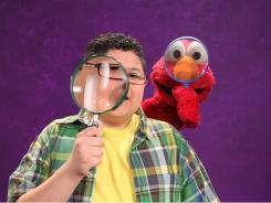 Modern Family 's Rico Rodriguez and Elmo investigate.