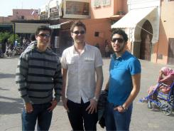 This Feb. 7, 2010, photo provided by Jake Hug shows him, center, with fellow students Brahim Mellouli, left, and Toshiro Baum from the International Institute of Higher Education in Morocco in the Djemma el-Fna square in Marrakech, Morocco.