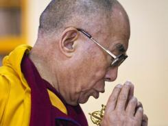 Tibetan spiritual leader the Dalai Lama prays Monday during a prayer session in Dharmsala, India.