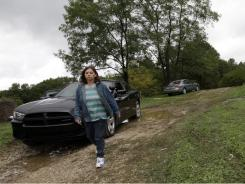 Teresa Richardson leaves after talking with a state trooper at the entrance to the home of her former brother-in-law, Roy Napier. Four people were found dead at the home near Laurel, Ind., on Monday. A fifth person was found dead across the street.