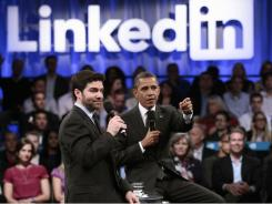 President Obama, accompanied by LinkedIn CEO Jeff Weiner, takes questions Monday at the Computer History Museum in Mountain View, Calif.