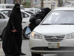 Saudi women board a taxi in Riyadh, Saudi Arabia, in May.