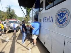 Flood victims line up to register at the FEMA command post in Prattsville, N.Y., after Tropical Storm Irene damaged the area late last month.