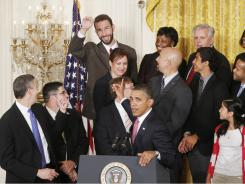 President Obama acknowledges fourth-grade teacher John Becker, top row center, as he  speaks to educators and students  about his changes to the No Child Left Behind law.