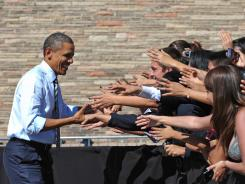 President Obama greets supporters before an address on his jobs plan Tuesday in Denver. His campaign is soliciting donations as low as $3 before the end of the third quarter.