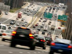 Traffic flows along I-495, the Capital Beltway, at the Virginia-Maryland state border. Washington-area drivers' commute is so bad mainly because their city is better off economically than most.
