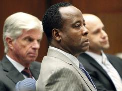 Conrad Murray listens to the prosecution's opening arguments in his involuntary-manslaughter trial in Los Angeles on Tuesday.