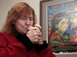 Glaucoma patient Elvy Musikka, 72, lights a marijuana cigarette  on Tuesday, one of many she regularly receives from the U.S. government, at her home in Eugene, Ore.