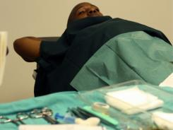 A Swazi man awaits to be circumcised in a massive, nationwide drive to circumcise its men in a bid to curb the spread of HIV.