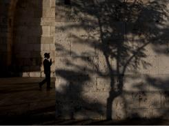 An Orthodox Jewish man walks toward the Jaffa Gate in Jerusalem's Old City in August. A few Muslim believers are crossing the Holy Land's volatile boundaries to bring Islam to Israel's Jews.