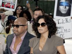 Michael Jackson's sister, Janet Jackson, and brother, Randy Jackson, arrive at court Thursday for the involuntary manslaughter trial of Dr. Conrad Murray in Los Angeles.