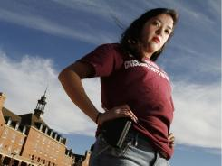 Adrienne O'Reilly carries an empty holster at Oklahoma State University to show support for a proposed gun bill.