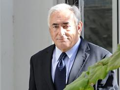 Former French IMF chief Dominique Strauss-Kahn, 62, leaves the financial crimes unit of the French police Thursday in Paris after meeting with a woman who has accused him of attempted rape.