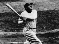 Babe Ruth watches his home run in this undated photo.