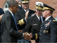 President Obama greets Martin Dempsey, right, alongside retiring Chairman Admiral Mike Mullen, center, at Fort Myer in Arlington, Virginia.