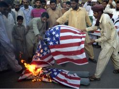 Protesters burn an effigy of U.S. Adm. Mike Mullen  during an anti-American rally in Multan, Pakistan, on Thursday.
