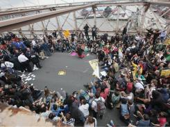 Police prepare to arrest demonstrators affiliated with the Occupy Wall Street movement after they attempted to cross the Brooklyn Bridge on the motorway on October 1, in New York.