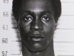 This arrest photo shows George Wright Feb. 15, 1963, in custody in the 1962 murder of a gas station owner in Wall, N.J.