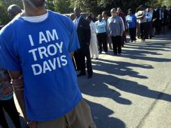People wait outside the Jonesville Baptist Church before the funeral of Troy Davis Saturday in Savannah, Ga.