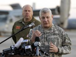 Army Gen. Carter Ham speaks at a news conference March 24 at the Sigonella airbase in Sicily, Italy. He said the military mission in Libya is largely complete.