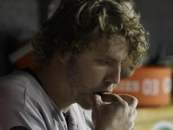 Baltimore Orioles player Mark Reynolds chews tobacco during a game.