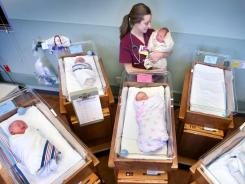 Alea Bowman, a certified nursing assistant, cares for newborns in Winchester, Va.