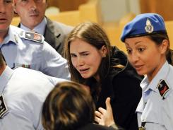 Amanda Knox reacts Monday after an eight-member jury overturned her conviction in the 2007 killing of her roommate, Meredith Kercher. Knox's ex-boyfriend Raffaele Sollecito was also acquitted.
